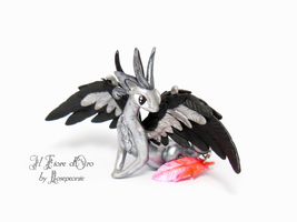 Silver Blackwing with feather (front) by rosepeonie