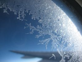 ice on aeroplane window by rottenappletowers