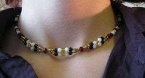 necklace - red and gold (on model) by Galasdian