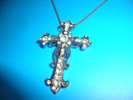 Cross necklace by Laura-in-china