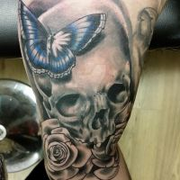 Skull and butterfly underarm tattoo by thirteen7s