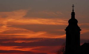 Burning sky and church by Steveewonder