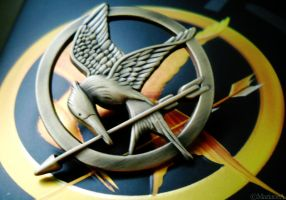 Mockingjay Pin by enairam11