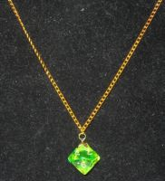 Green and gold magma ten-sider pendant by BlackUnicornWood