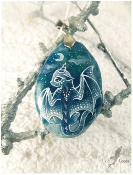 Snowy lunar baby dragon - stone painting by AlviaAlcedo
