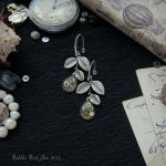 Steampunk floral earrings with lab rubies by IkushIkush