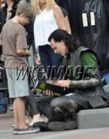 Loki giving autograph by HarmonyB2011